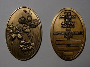 Mary Swords DeBaillon Medal showing both sides of the medal