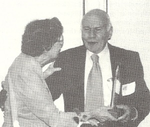 Joseph Mertzweiller is presented the SLI Distinguished Merit Award by Barbara Nelson at the SLI Convention in 1992.